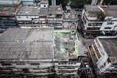 stock photo of overpopulation  - Poor home or slums facade in Bangkok city Thailand - JPG