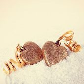 foto of two hearts  - Two gold hearts on snow - JPG