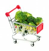 picture of cruciferous  - Studio shot of freshly cut green broccoli in mini shopping trolley - JPG