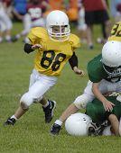 stock photo of jock  - Teams battling in youth football.  - JPG