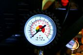 picture of air compressor  - Scale of an air compressor in a car workshop - JPG