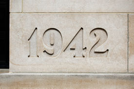 picture of cornerstone  - Cornerstone with year 1942 on it in light brown stone - JPG