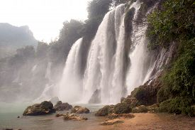 picture of bans  - Ban Gioc Waterfall on the Quy Xuan River is located in Cao Bang Province, nears the Sino-Vietnamese border. The waterfall falls thirty meters. Located  in  Northern of Vietnam. It is the largest waterfall in Asia and the fourth largest waterfall 