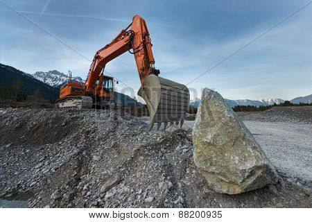 huge shovel excavator standing on gravel hill