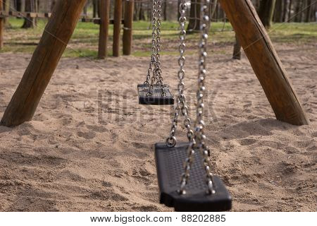 Empty swing on children playground