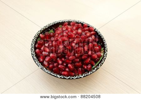 Pomegranate Seeds On A Plate