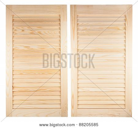 Two Unpainted Wooden Shutters