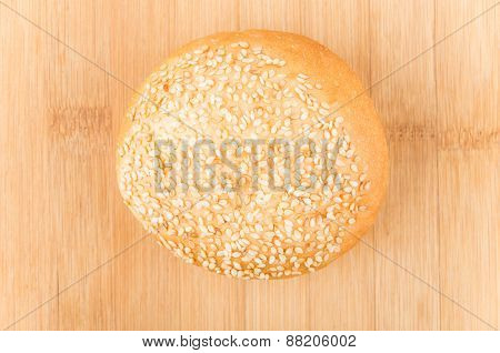 Bun Sprinkled With Sesame Seeds On Bamboo Board