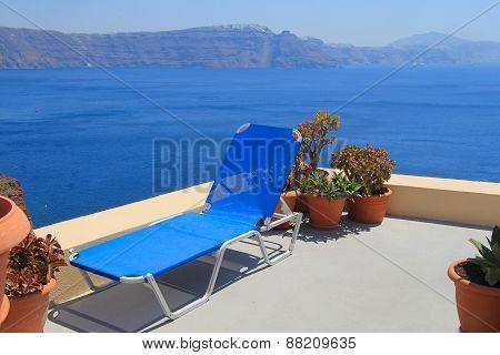 Blue Lounge Chair Against The Sea, Santorini