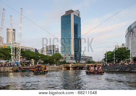 Colorful riverboats cruise along the Singapore River