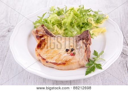 fried pork with salad