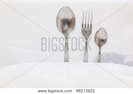 Spoons And Forks, Small Spoons On A White Background