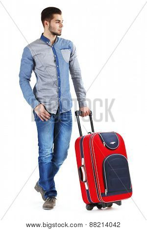 Man in blue shirt and jeans with suitcase isolated on white