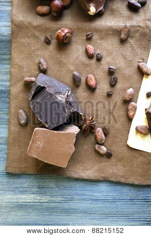 Delicious chocolate with spices on table, closeup