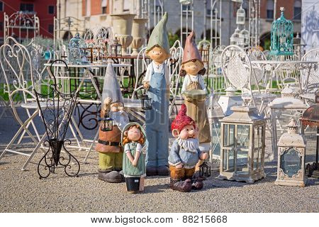 PISA, ITALY - APRIL 11, 2015: Antiques and garden gnomes Pisa on the street of Pisa in Italy. Pisa is a city in Tuscany known worldwide for the Leaning Tower, one of the biggest landmark.