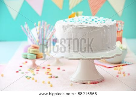 Birthday decorated cake on color background