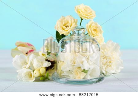 Beautiful composition with flowers on turquoise background