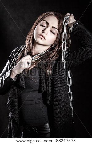 Young Woman In A Black Clothes With A Chain