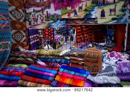 Colorful textile stall in the popular Otavalo market, Ecuador