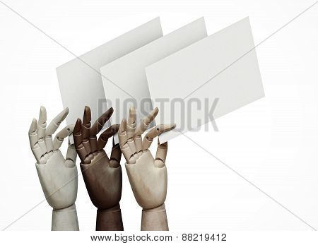 Wood Hands Of Different Colors Holding Blank Pages