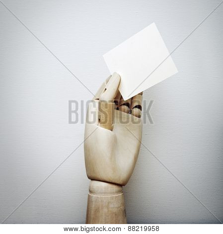 Wood Hand Holding White Business Card