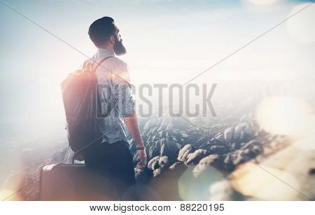 Bearded Guy Lookig At Mountain. With Flares