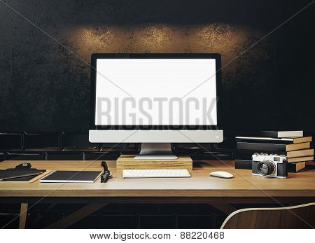 Mock Up Of Generic Design Computer Screen On The Table. Workspace In The Black Loft. 3D Rendering