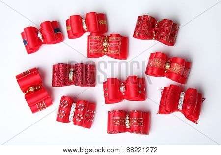 Red Dog Hair Bows On White Background