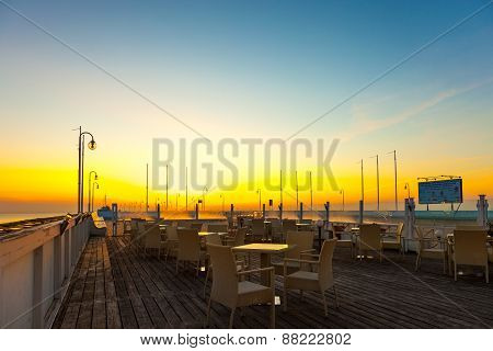 Empty Tables And Chairs With Sea Views