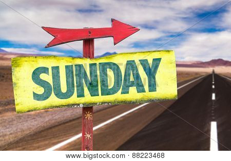 Sunday sign with road background