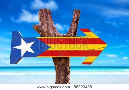 Catalonia Flag wooden sign with beach background