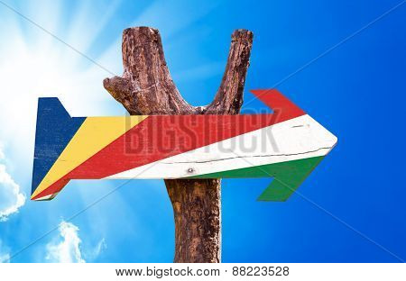 Seychelles Flag wooden sign with sky background