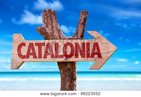 Catalonia wooden sign with beach background