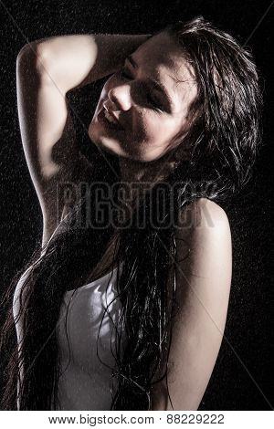 Portrait Of A Beautiful Young Woman Staying Under Water Splashes