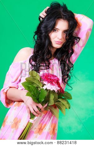 Beautiful Young Brunette In A Pink Dress With A Bunch Of Gerberas