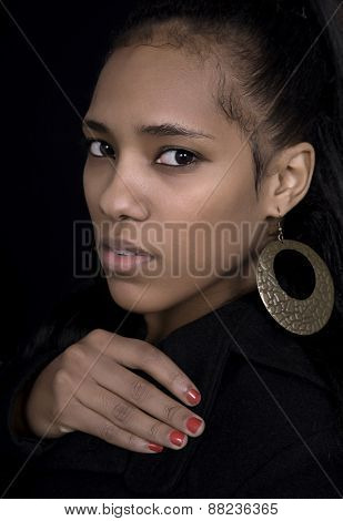 young beautiful african woman close up portrait, on black background