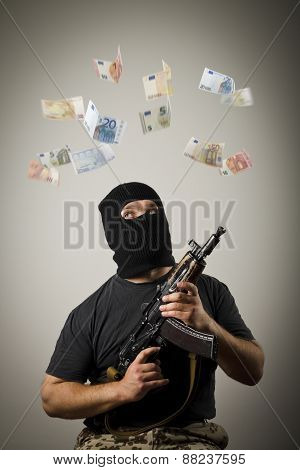 Man With Gun And Euro Banknotes.