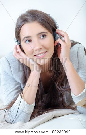 Young brunette is a music fan