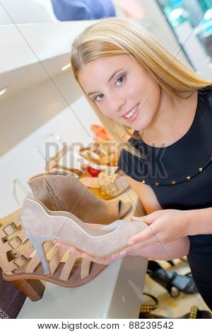 Lady holding shoe