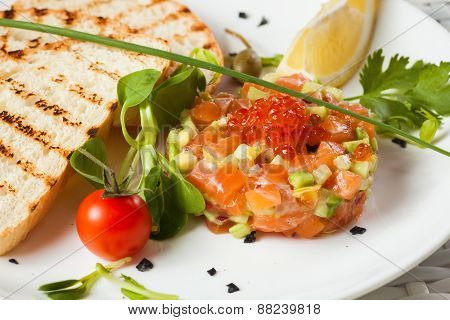 Salmon Tartar on a light background. Starter close up