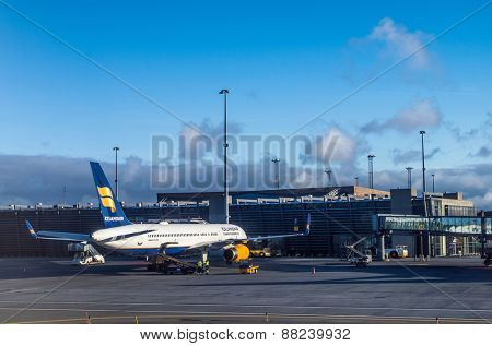 KEFLAVIK, ICELAND - March 15, 2015: Icelandair Boeing B757 in early morning, parked at Keflavik International airport near Reykjavik, Iceland.