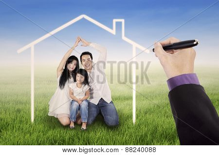 Excited Family Under A Dream House