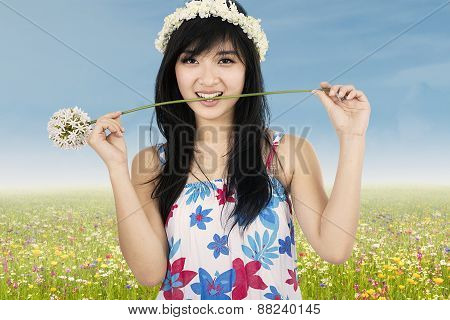Cute Beautiful Woman Biting Flower