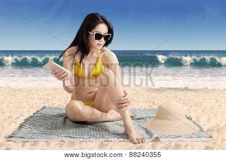 Female Tourist Using Sun Cream