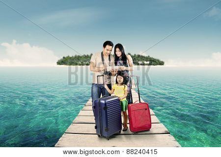 Happy Family Looking At Digital Map