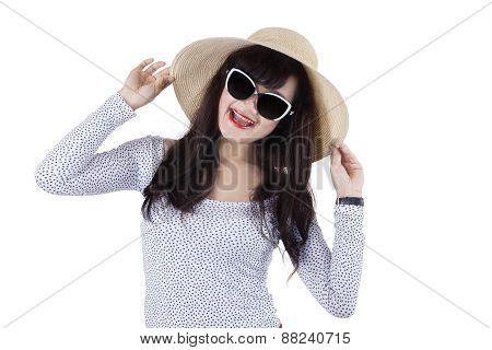 Happy Woman With A Hat In Studio