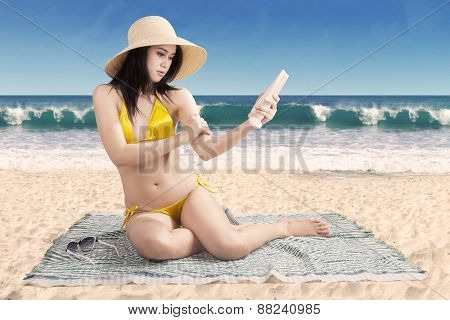 Pretty Woman With Suntan Lotion