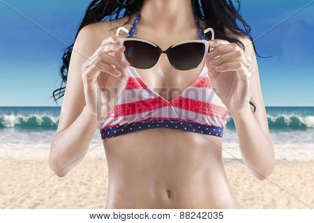 Sexy Woman Body Holds Sun glasses