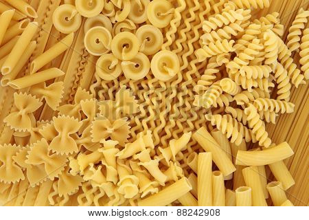 Large pasta food selection forming an abstract background.