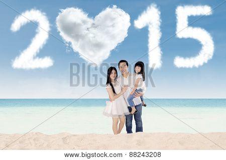 Three Member Of Happy Family On Beach